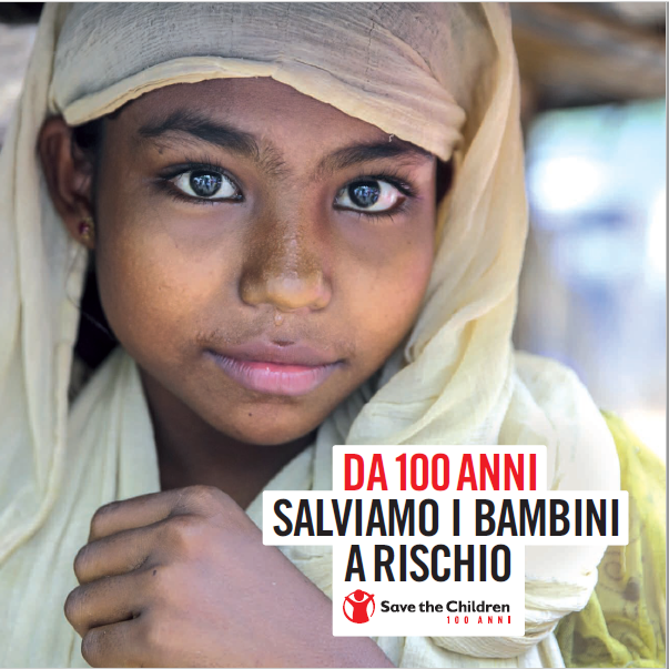 copertina dossier 100 anni di Save the Children con bambina velata in primo piano